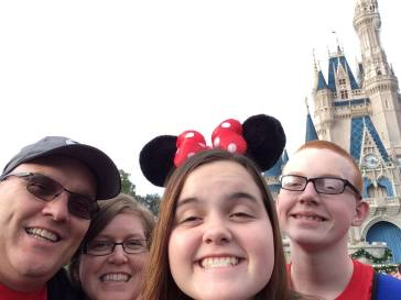 Jacki with her husband, Larry, and their two teenagers at Disney World