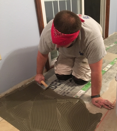 Watch and Learn: Installing floor tile. Home remodeling. Family. Children. Work.